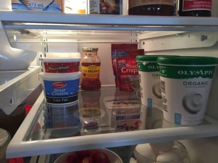 Staples in our fridge: garlic butter (back left corner, sour cream, chip dip (for my hubby), and yogurt for breakfast